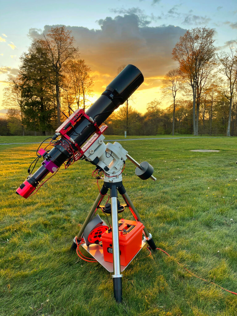 My Explore Scientific FCD100 127mm with a beautiful sunset behind it.